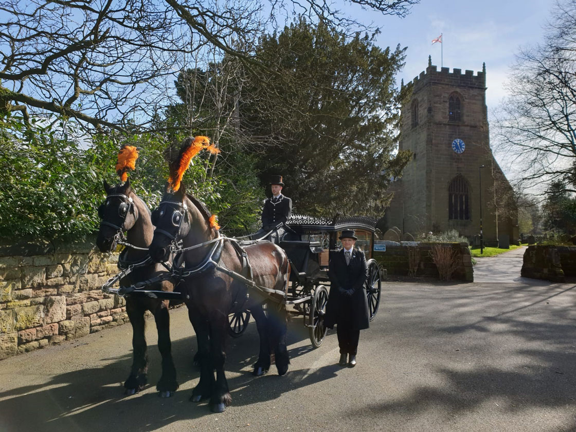 black horse drawn hearse as supplied by Sincerity Funerals Funeral Directors Wolverhampton