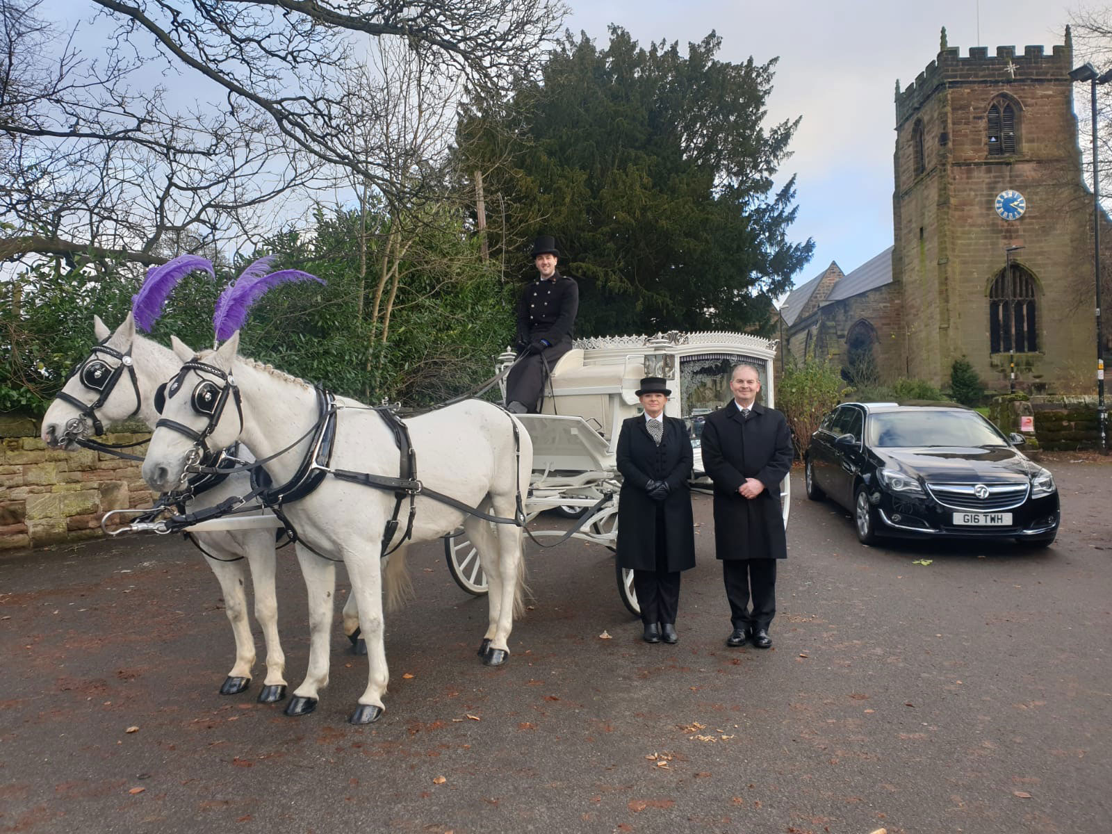 white horse drawn hearse as supplied by Sincerity Funerals Funeral Director Wolverhampton