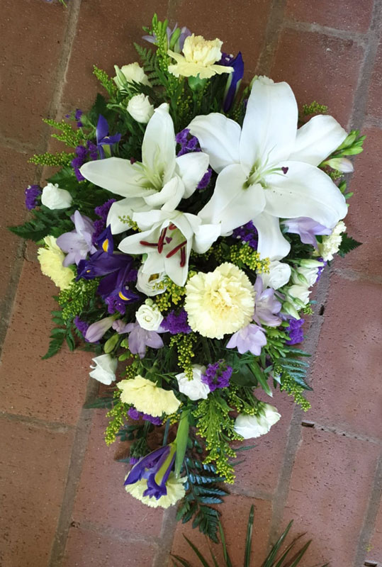 white funeral roses with green stems